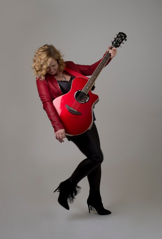 Danish Musician Jessica Lynne with Guitar