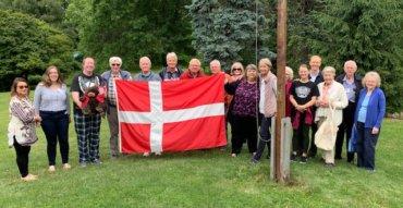 Danish American Cultural Retreat group with Danish Flag